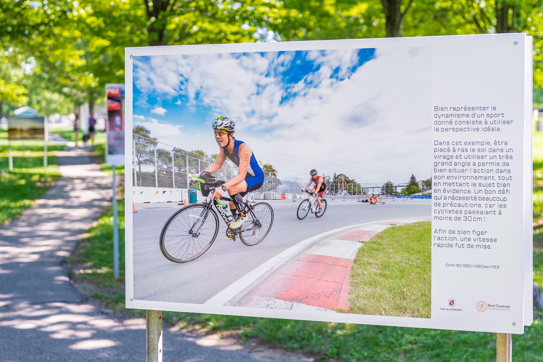 Triatlon Montréal. Cycliste autour du circuit Gilles Villeneuve.  Panneau exposition en plein air au parc Lorraine, KW:  Lorraine